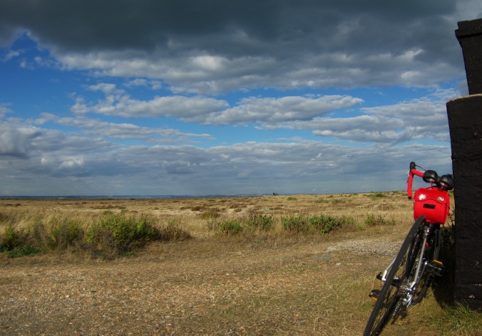 Road bike leaning against a wall at Dungeness