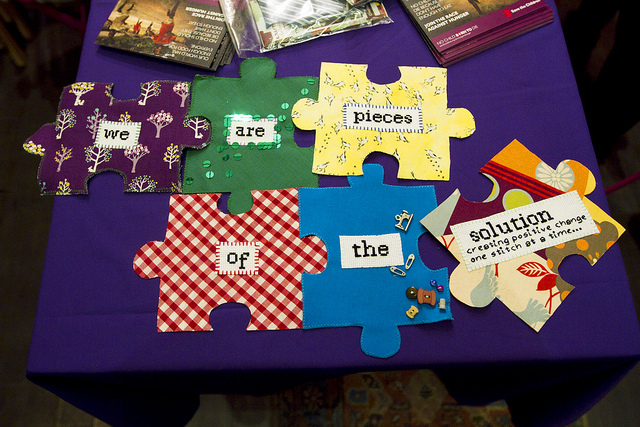 fabric jigsaw pieces say 'We are all part of the solution'