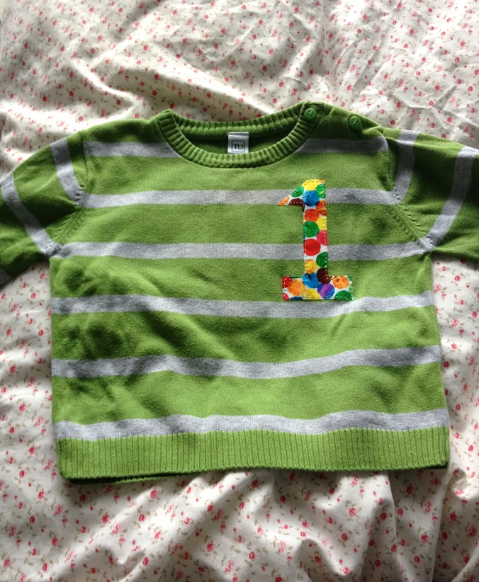 Front of upcycled baby sweater